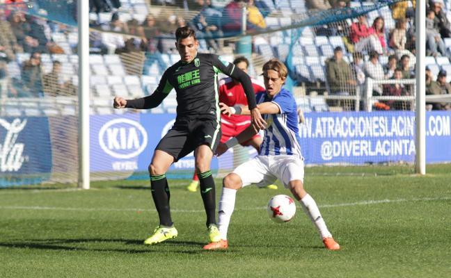 Trabajo defensivo del Granada B en Huelva para conseguir un punto