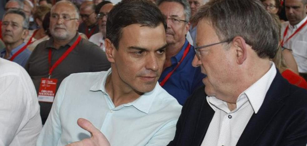 Reconciliación forzada de Sánchez y Puig en el congreso valenciano