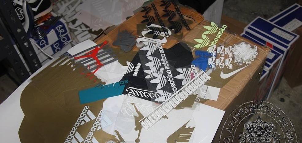 Localizan en Granada un taller de falsificación de primeras marcas