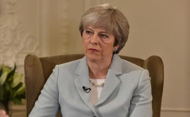 Theresa May confirma un reajuste inminente de su Gobierno