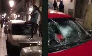 El impactante vídeo de la Policía sobre los disturbios de Lavapiés: destrozando coches y saltando encima de las lunas