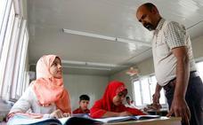 Los niños gitanos vuelven al colegio en Irak por primera vez en 14 años