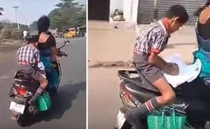 El vídeo que emociona a la Red: hace sus deberes sobre una moto en marcha con su madre conduciendo