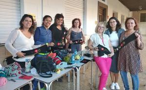Éxito del taller de fajines y broches tradicionales del traje de aldeana típico de San Torcuato