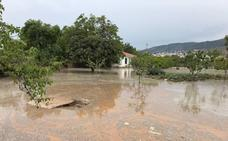 200 invitados a una comunión quedan aislados durante horas tras las lluvias de Padul
