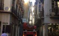 Despredimientos en una fachada del Centro de Granada