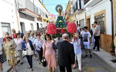 La Virgen del Pilar procesiona por su barrio