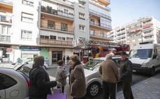 Una anciana con alzhéimer pasa varios días con su hijo fallecido en el sillón de su casa de Granada