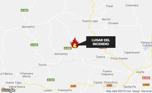 Extinguido un incendio en un descampado junto a unas viviendas en Íllora
