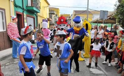Una cabalgata da comienzo a las fiestas de la barriada Las Américas de Linares